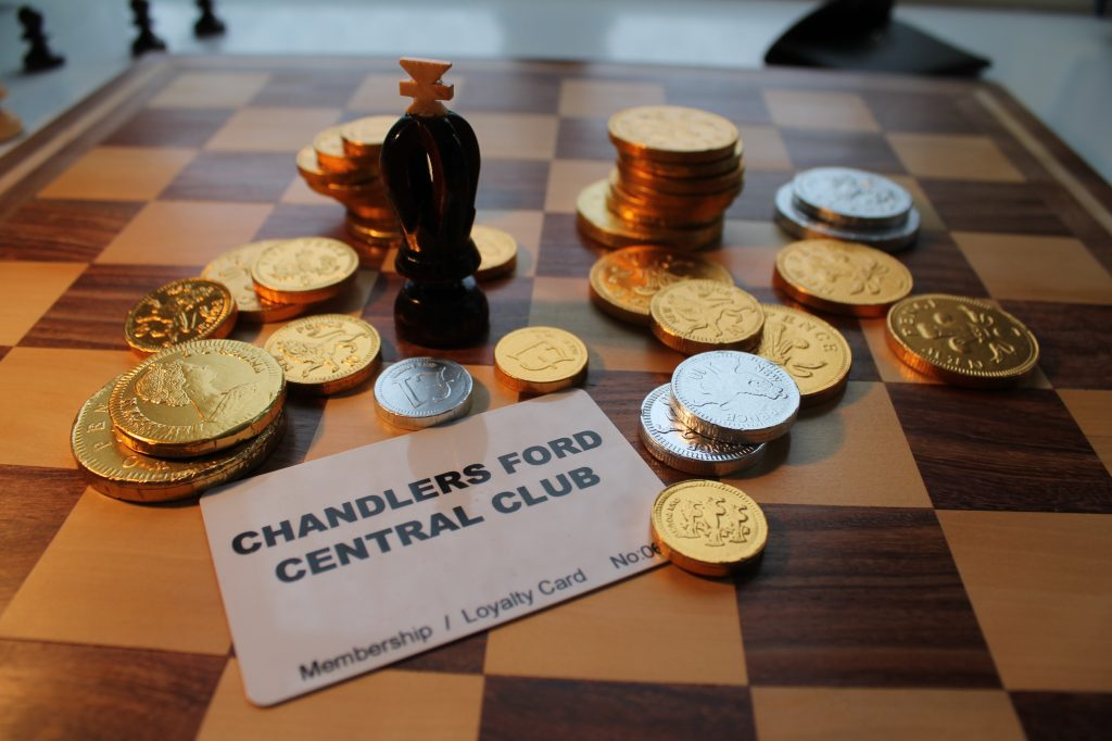Chandler's Ford Central Club membership card with choc coins on chess board