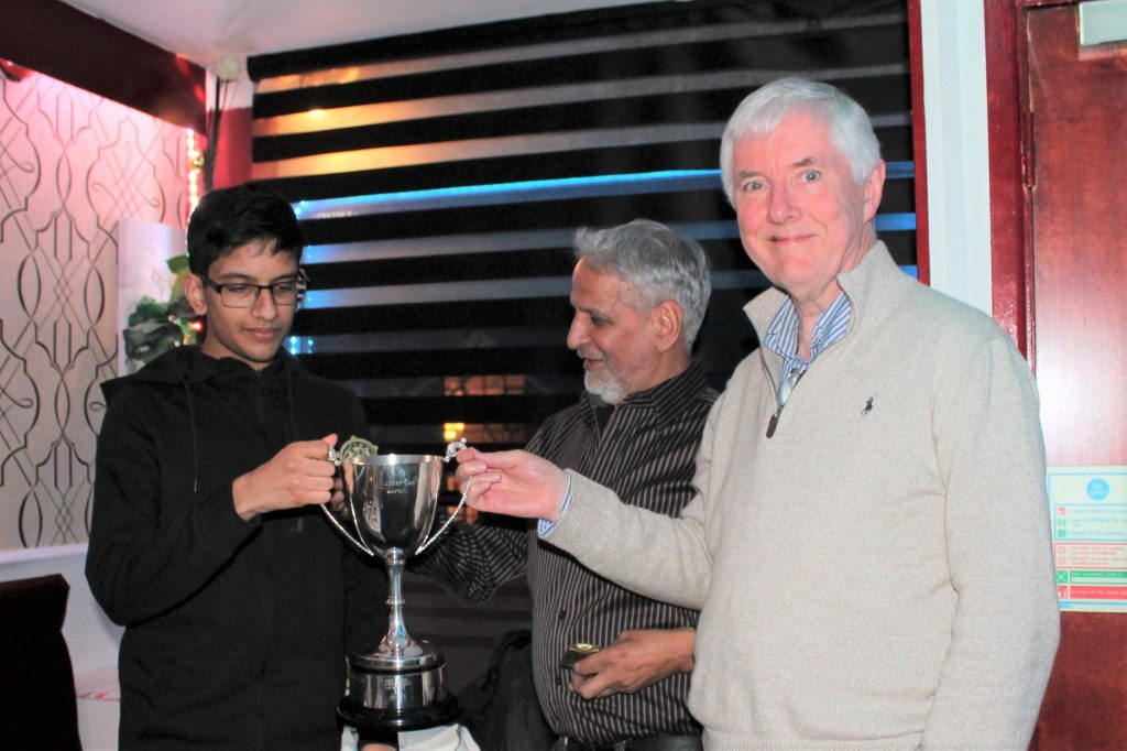 John Kooner presents the Summer Tournament's Kooner Cup to 2018 joint winners Manoj Chandar and Sam Murphy