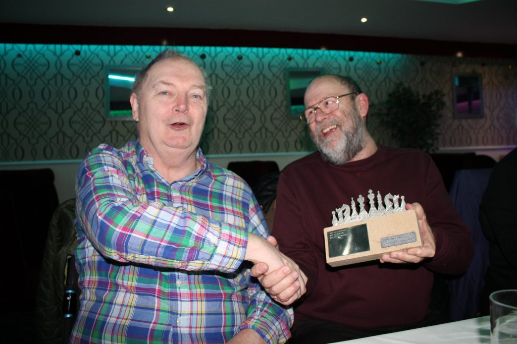 Steve Dunleavy (left) presents the Knockout Trophy to Peter Przybycin