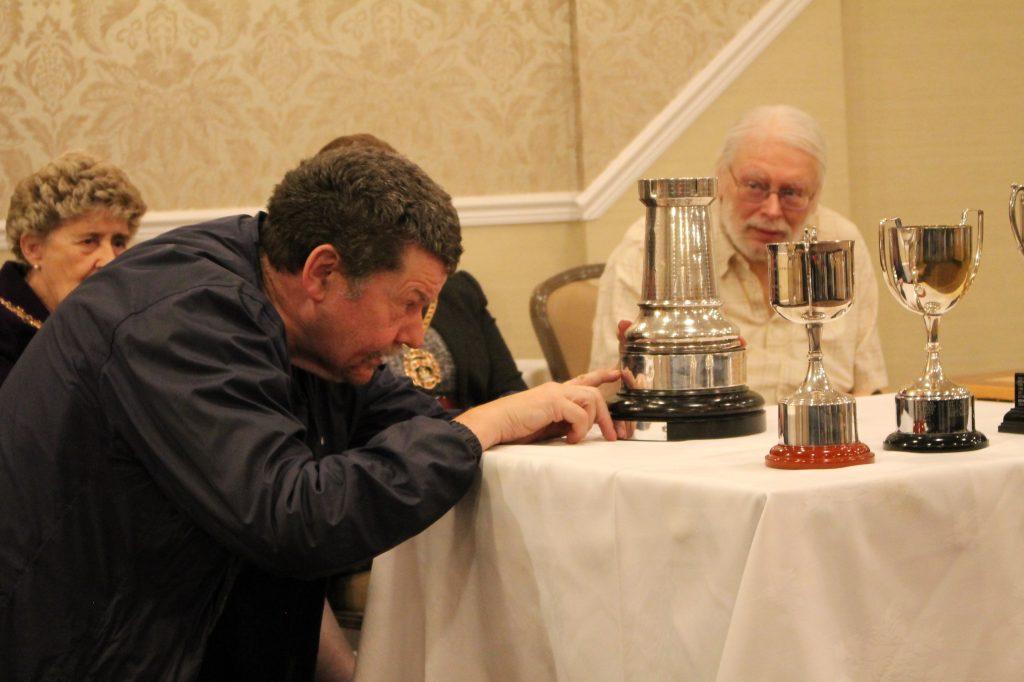 Malcolm Clarke inspects trophy