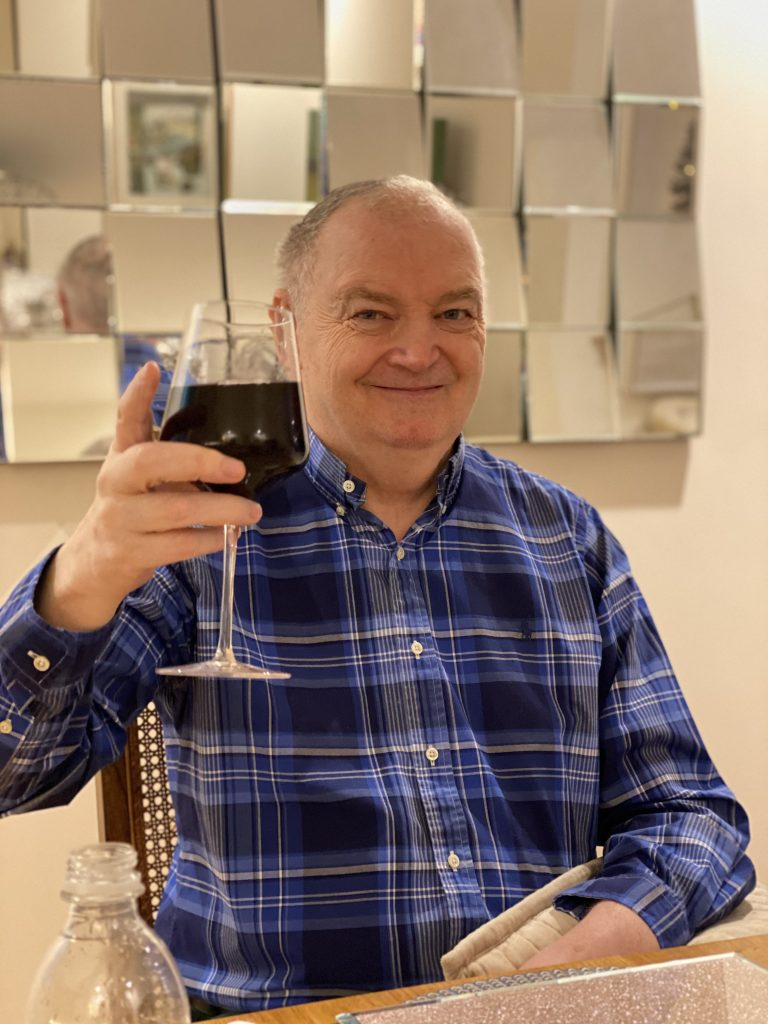 Cheers! Steve Dunleavy raises a glass