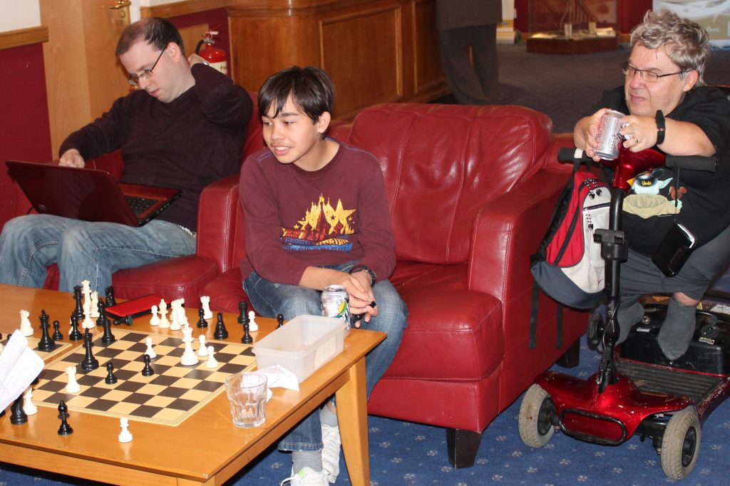 Joseph Henbury (centre) and Michael Henbury (right) analysing a chess game at Dudley 2013
